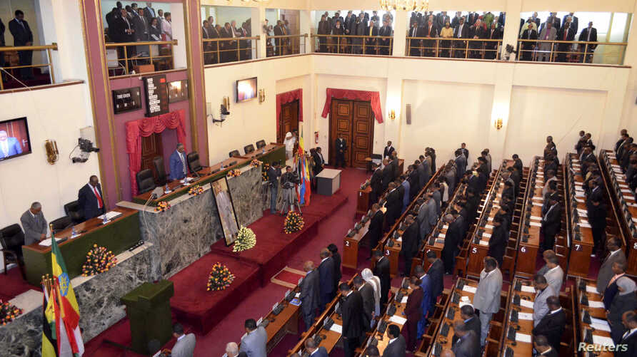 Ethiopian legislators observe a minute of silence in honor of the late Prime Minister Meles Zenawi before swearing-in Prime Minister Hailemariam Dessalegn, Addis Ababa, Sept. 21, 2012.