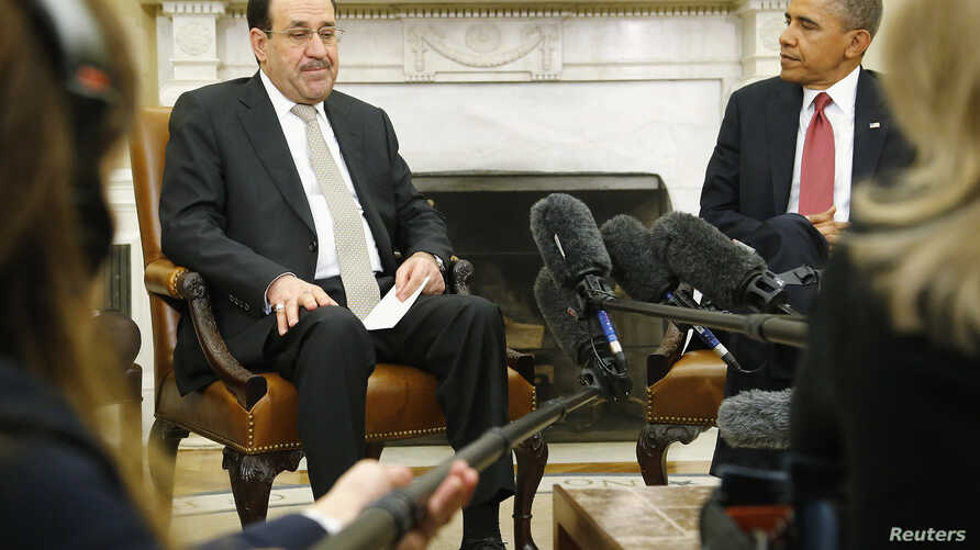 Iraqi Prime Minister Nuri al-Maliki (L) and U.S. President Barack Obama (R) pause for translation as they talk to reporters in the Oval Office after meeting at the White House in Washington, November 1, 2013.