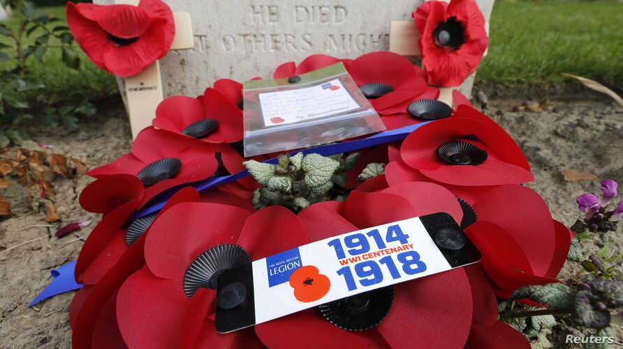 A wreath of poppies in memory of fallen soldiers is seen at Ramparts Cemetery in Ypres, Belgium, home of one of WWI's deadliest battles, June 25, 2014.