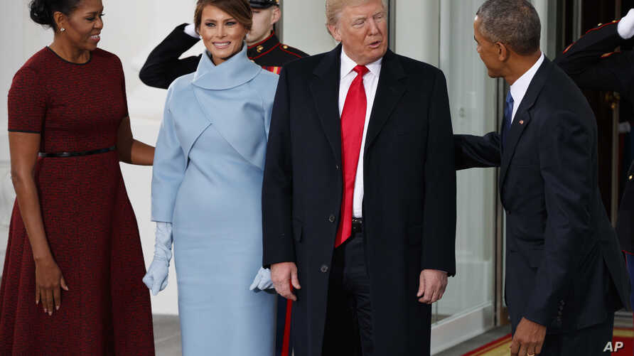 FILE - President Barack Obama and first lady Michelle Obama greet President-elect Donald Trump and Melania Trump at the White House, Jan. 20, 2017.
