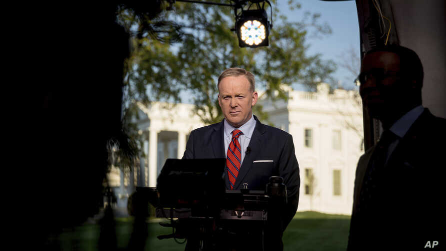 """White House press secretary Sean Spicer prepares to go on cable news on the North Lawn of the White House in Washington, April 11, 2017. Spicer apologized for making an """"insensitive"""" reference to the Holocaust in earlier comments about Syrian Preside"""
