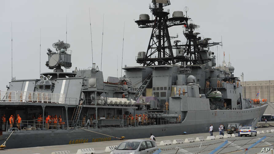FILE - Russian sailors are seen aboard the Admiral Panteleyev Russian warship moored at the Mediterranean port of Limassol, Cyprus, May 17, 2013.