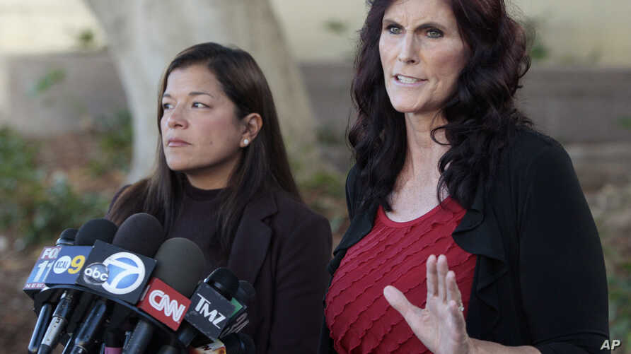 Cindy Lee Garcia, right, and attorney M. Cris Armenta hold a news conference before a hearing at Los Angeles Superior Court in Los Angeles, September 20, 2012.