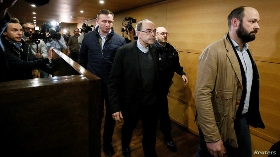 Cardinal Philippe Barbarin, Archbishop of Lyon, walks inside the courthouse during a break in his trial, charged with failing to act on historical allegations of sexual abuse of boy scouts by a priest in his diocese, at the courthouse in Lyon, France