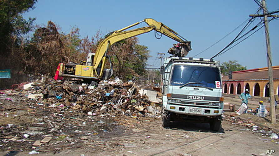 A backhoe performs flood recovery work in Muang Ake, Bangkok.