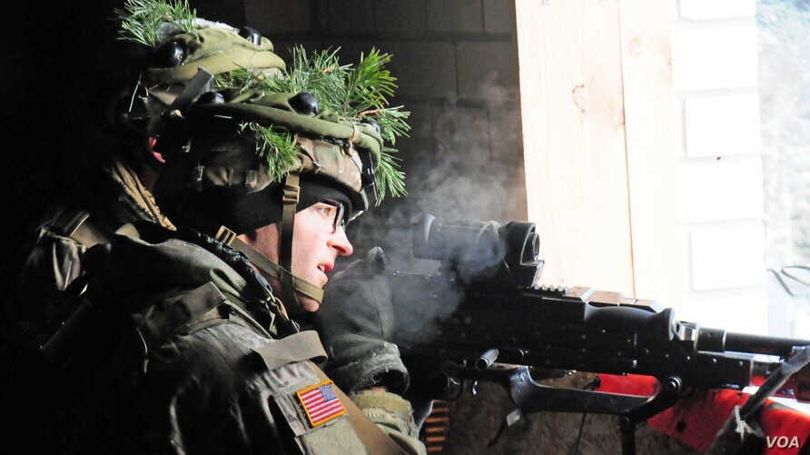 A U.S. paratrooper participates in a NATO exercise at an urban training center in Pabrade, Lithuania, Nov. 29, 2016.
