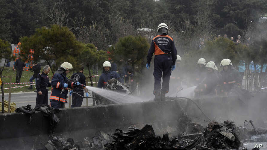 Firefighters work on the site shortly after a helicopter with seven people inside was crashed in Istanbul's Buyukcekmece district, March 10, 2017.