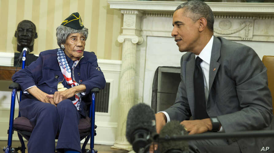 President Barack Obama meets with Emma Didlake, 110, of Detroit, the oldest known World War II veteran, July 17, 2015, in the Oval Office of the White House in Washington.