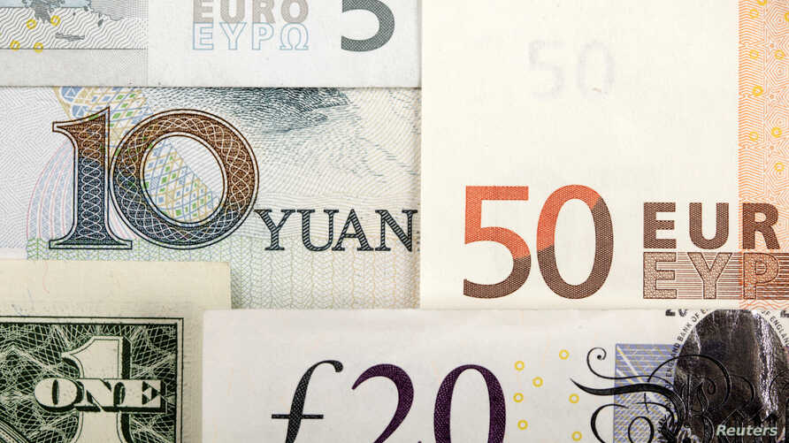 FILE -  The Chinese yuan, shown Jan. 25, 2011, with the U.S. dollar, euro and British pound, is gradually moving to become a more market-oriented currency, and its international profile is growing.