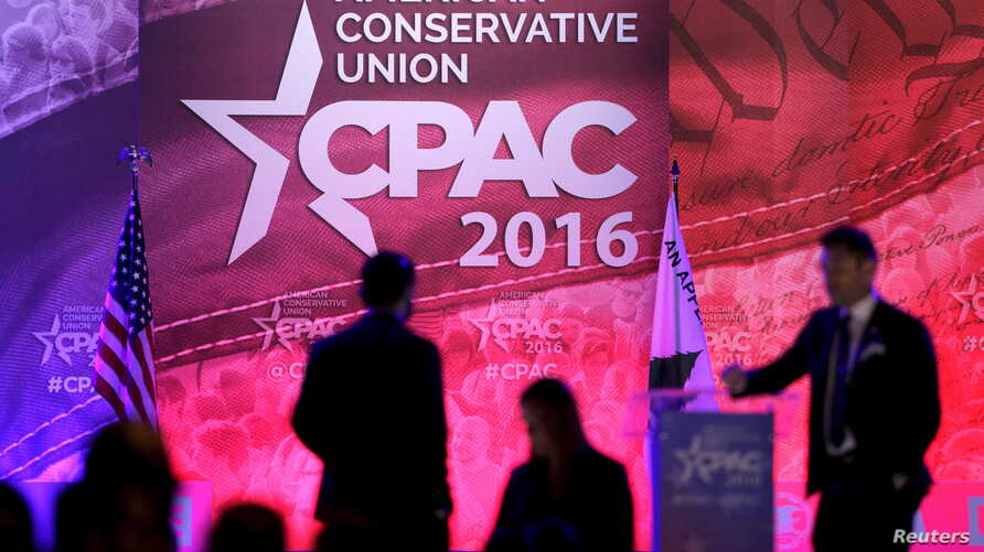 FILE - People walk on the stage on the final day of the 2016 Conservative Political Action Conference (CPAC) at National Harbor, Maryland, March 5, 2016.