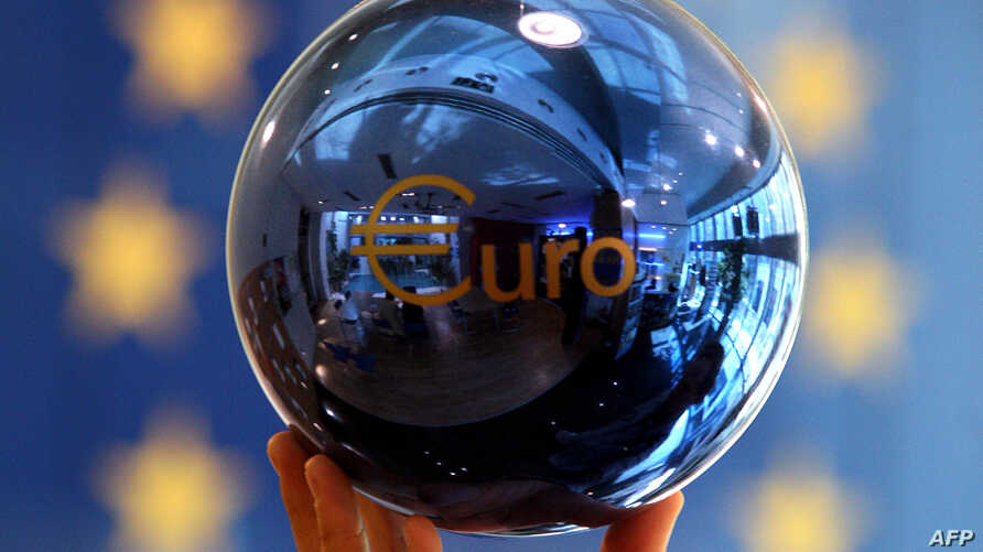 FILE - A person adjusts an EU decoration ball at the European Commission delegation building in Sofia, Bulgaria.