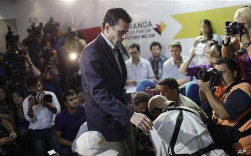 Henrique Capriles arrives for a press conference in Caracas, Venezuela, on March 10, 2013, to announce he will run in elections to replace late President Hugo Chavez.