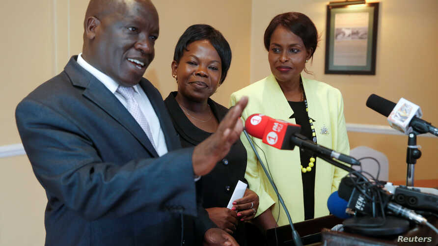Kenyan commissioners Nkatha Maina (R), Margaret Mwachanya and Paul Kurgat from Kenya's Independent Electoral and Boundaries Commission (IEBC) attend a news conference where they announced their resignation in Nairobi, Kenya, April 16, 2018.