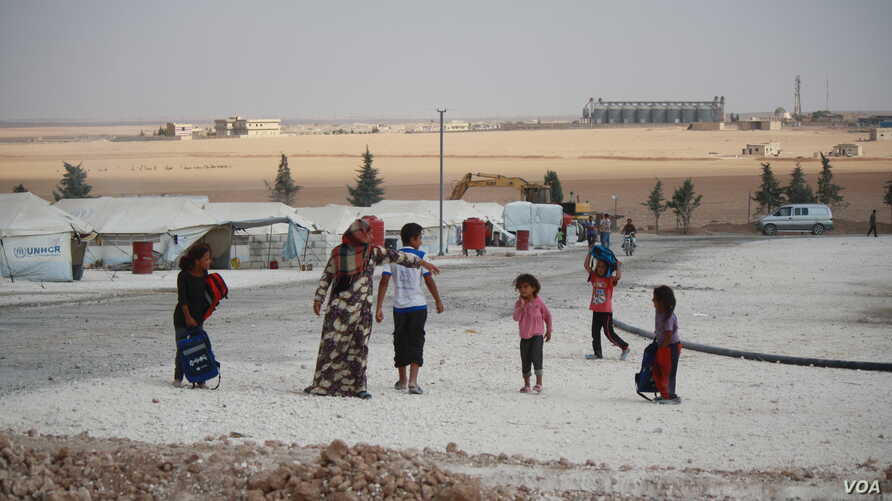 At the Ain Issa camp, Aug. 17, 2017,  in northeastern Syria, some men say they left their families behind as they fled forced consription by Islamic State militants. (H.Murdock/VOA)
