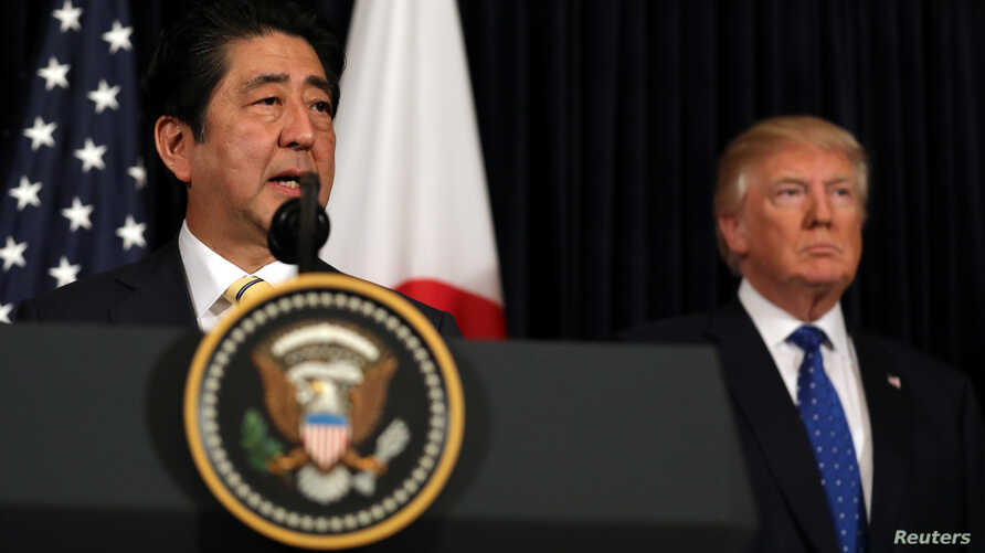 Japanese Prime Minister Shinzo Abe delivers remarks on North Korea accompanied by U.S. President Donald Trump at Mar-a-Lago club in Palm Beach, Florida, Feb. 11, 2017.
