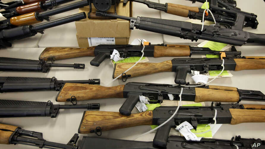 FILE - A cache of seized weapons is displayed in Phoenix, Jan 25, 2011.