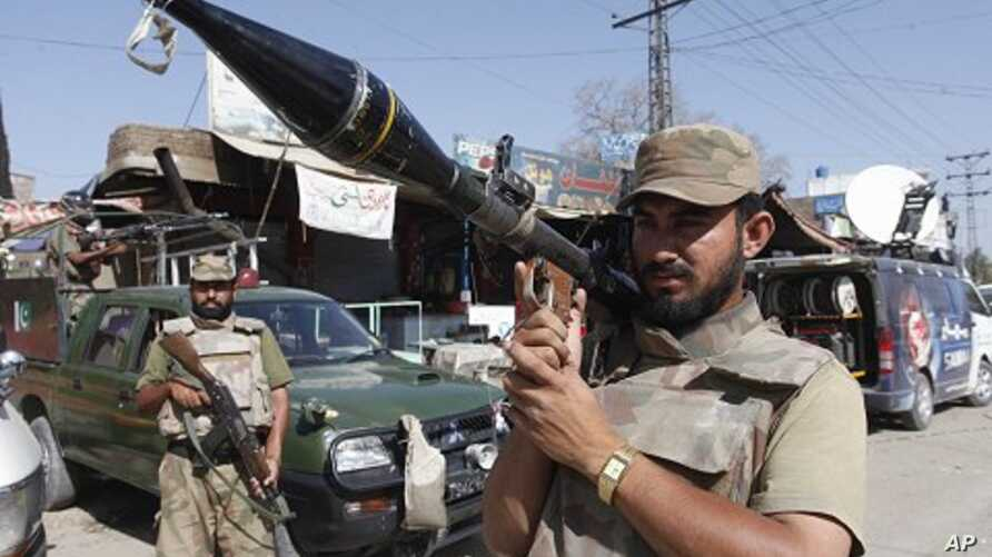 Pakistan army soldiers are on alert at the site of a bombing in Shabqadar near Peshawar, Pakistan (File Photo)