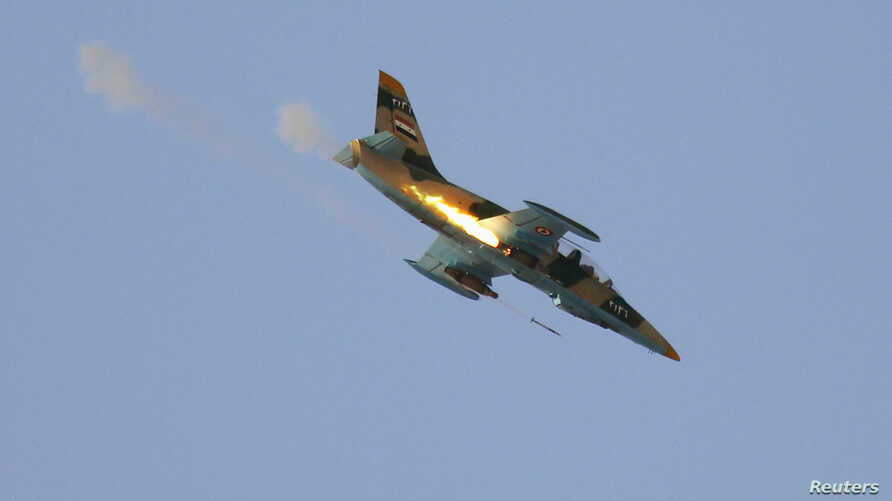 A Syrian Air Force fighter plane fires a rocket during an air strike in the village of Tel Rafat, some 37 km (23 miles) north of Aleppo, August 9, 2012.