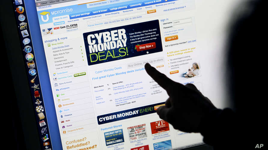 Consumer Carol Uyeno looks at Cyber Monday sales on her computer at her home in Palo Alto, Calif., Nov. 29, 2010.