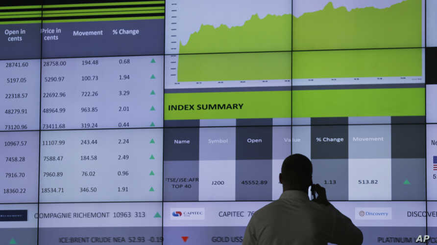 A worker at the  Stock Exchange in Johannesburg, South Africa, uses his mobile phone, April 4, 2017.