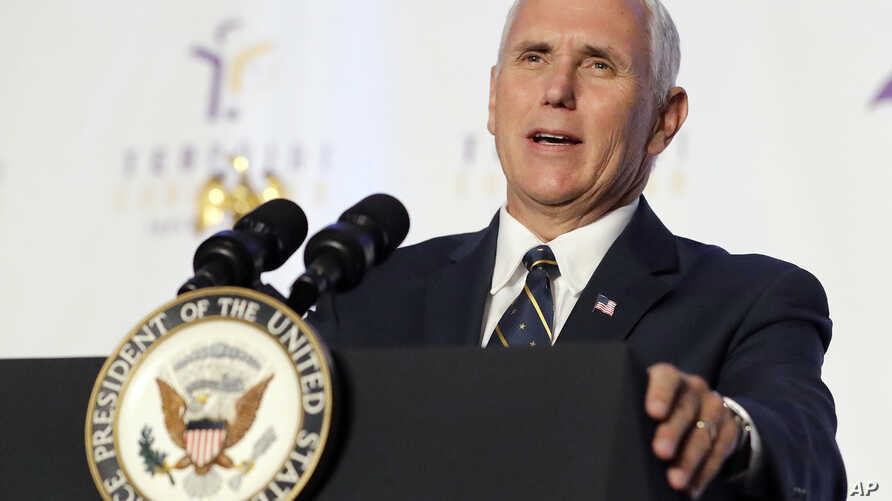 Vice President Mike Pence speaks during a luncheon in Indianapolis, Aug. 11, 2017.