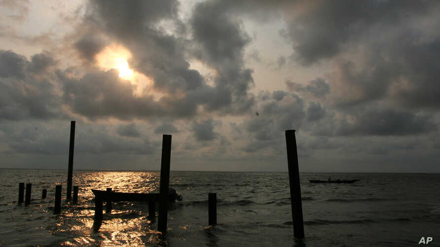 Locals fish at sunset in the  creeks of the oil rich Bakassi Peninsula ,August 11, 2006.