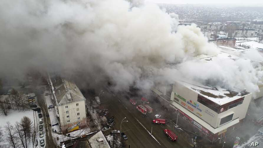 In this Russian Emergency Situations Ministry photo, on Sunday, March 25, 2018, smoke rises above a multi-story shopping center in the Siberian city of Kemerovo, about 3,000 kilometers (1,900 miles) east of Moscow, Russia.