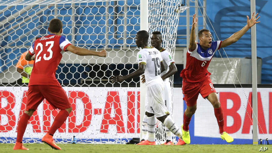 United States' John Brooks right, celebrates after scoring his side's second goal during the group G World Cup soccer match between Ghana and the United States at the Arena das Dunas in Natal, Brazil, June 16, 2014.