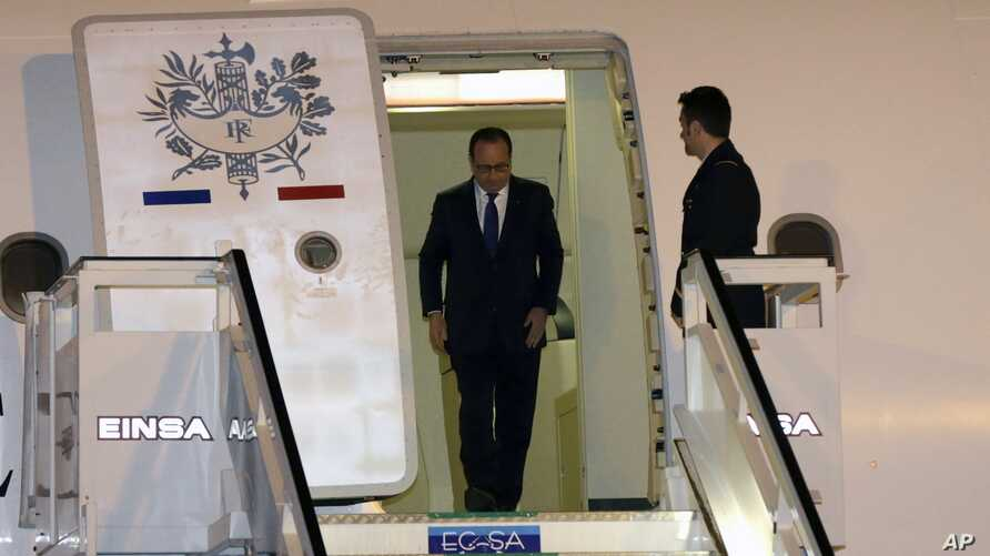 French President Francois Hollande arrives to the Jose Marti Airport in Havana, Cuba, Sunday, May 10, 2015.  Hollande is the first French president to ever visit communist Cuba, bringing along five ministers and two dozen business people.(AP Photo/De...