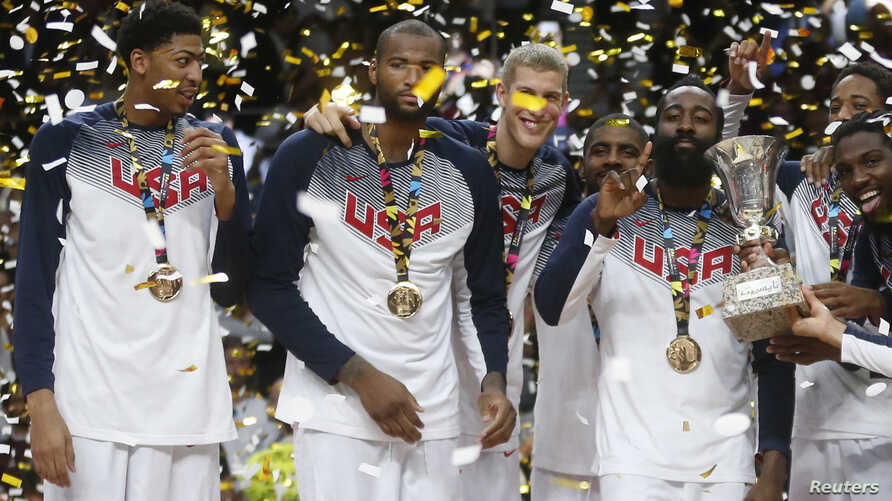 U.S. players celebrate winning their Basketball World Cup final game against Serbia in Madrid Sept. 14, 2014.