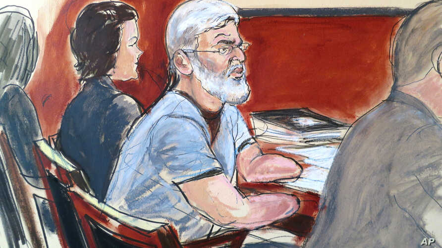 In this courtroom drawing, Mustafa Kamel Mustafa , center, is flanked by his defense team, attorney Julie Howe, left, and Joshua Dratel, right, in New York, April 14, 2014.