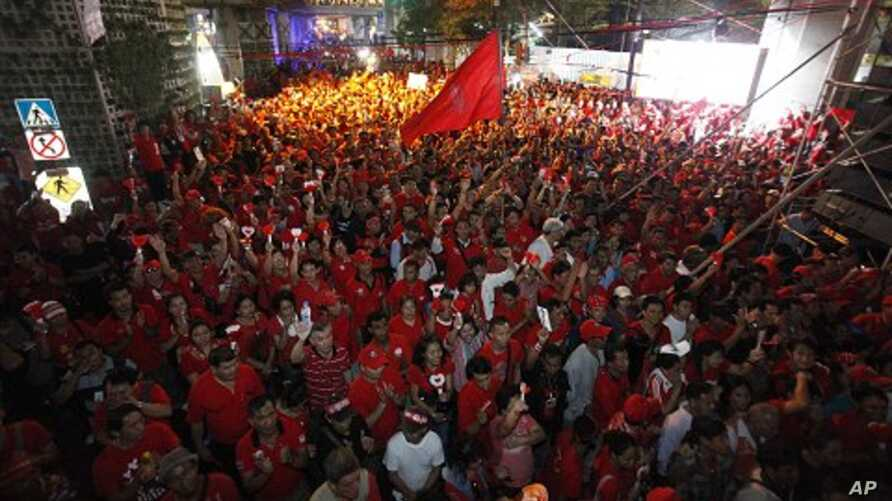 Thai anti-government 'red shirt' protesters gather at Bangkok's shopping district, decorated in red colors, 09 Jan 2011