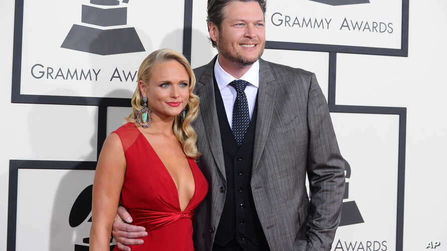 Miranda Lambert, left, and Blake Shelton arrive at the 56th annual GRAMMY Awards at Staples Center on Jan. 26, 2014, in Los Angeles.