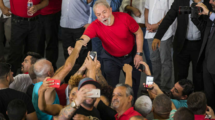 Former President Luiz Inacio Lula da Silva greets supporters during a visit to the metallurgic syndicate headquarters in Sao Bernardo do Campo, Brazil, Jan. 24, 2018.