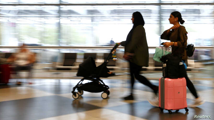 FILE - People arrive at Munich airport, in Munich Germany, August 3, 2017. Turkey is advising its citizens to avoid travel to Germany.