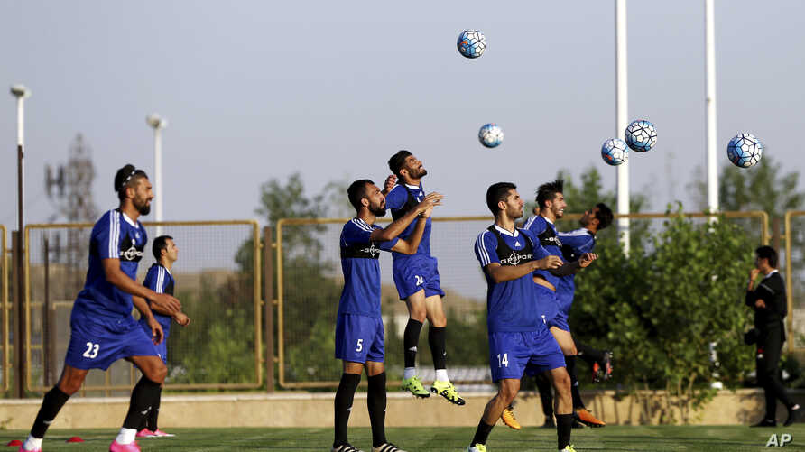 FILE - Iran's national soccer team is seen training in Tehran, Iran, Sept. 4, 2017.