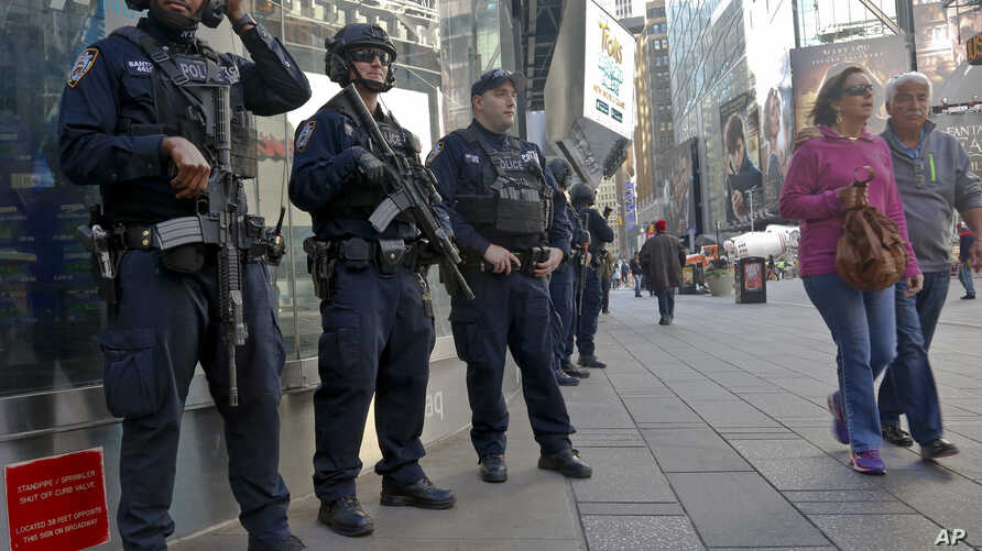 Officers from the New York Police Department's anti-terror unit patrol Times Square, Nov. 4, 2016. Police and the FBI are assessing information they received of a possible al-Qaida terror attack against the U.S. on the eve of Election Day.