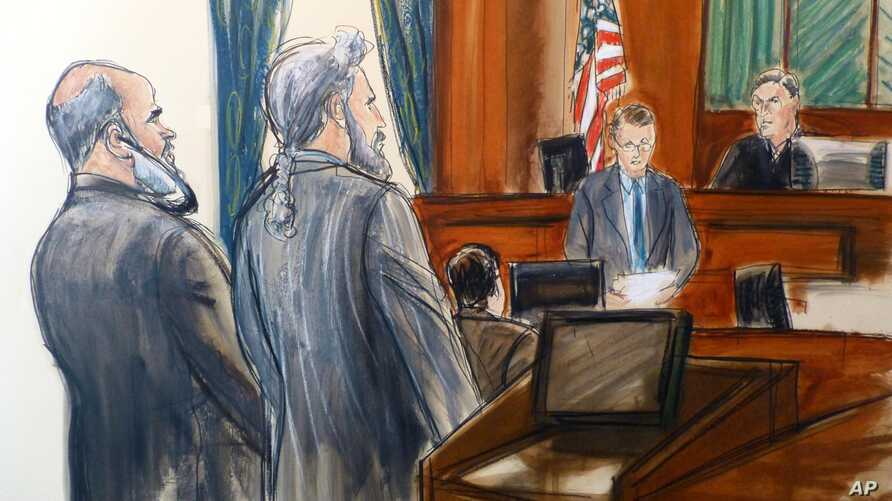 In this courtroom sketch, from left, Suleiman Abu Ghaith stands next to his attorney, Stanley Cohen, as courtroom deputy Andrew Mohan, reads the verdict and Judge Lewis Kaplan, right, listens, March 26, 2014 at federal court in New York.