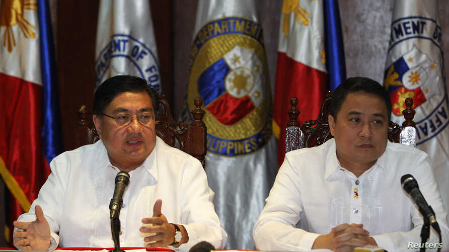 Philippine chief government negotiator Carlos Sorreta (L) speaks next to Pio Lorenzo Batino, Philippine Department of National Defense, Undersecretary for Legal and Legislative Affairs and Strategic Concerns during a news conference at the military h