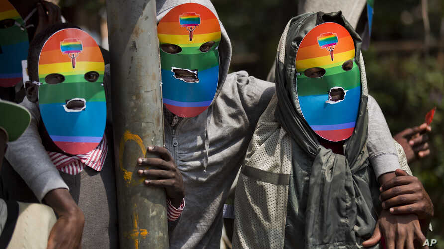 Kenyan gays and lesbians and others supporting their cause wear masks to preserve their anonymity as they stage a rare protest, against Uganda's increasingly tough stance against homosexuality and in solidarity with their counterparts there, outside