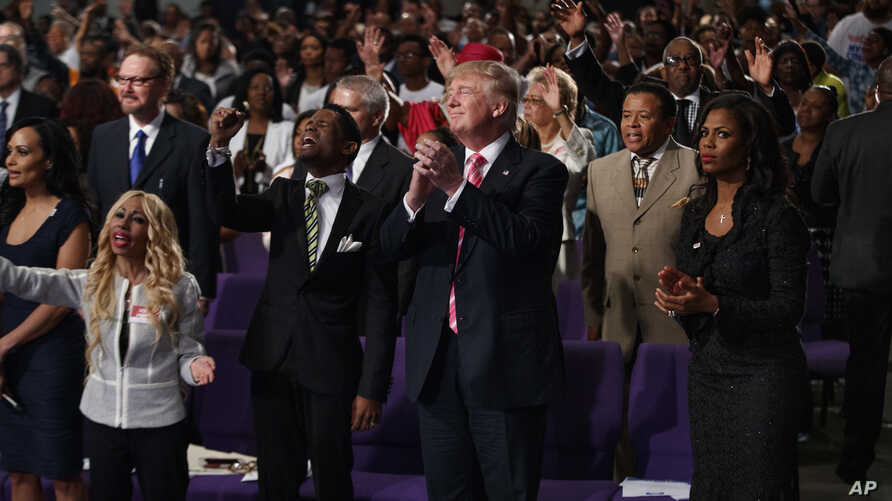 Republican presidential candidate Donald Trump shown during a church service at Great Faith Ministries, Saturday, Sept. 3, 2016.