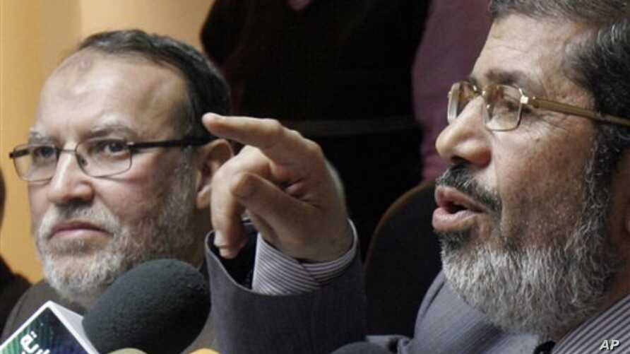 Senior members of Egypt's  Muslim Brotherhood Mohamed Morsi,  right,  and  Essam el-Erian  hold a press conference on the latest situation in Egypt in Cairo, Egypt, Wednesday, Feb. 9, 2011.  (AP Photo/ Mohammed Abou Zaid)