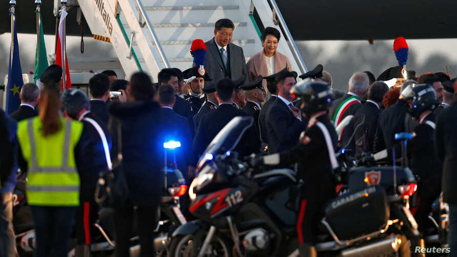 Chinese President Xi Jinping and his wife Peng Liyuan arrive at Fiumicino airport ahead of a visit to Rome and the Sicilian capital Palermo, in Rome, Italy, March 21, 2019.
