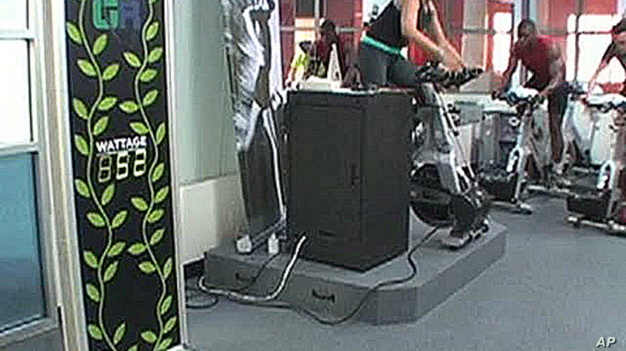 Health club members can see how much electricity they generate while riding their exercise bikes.