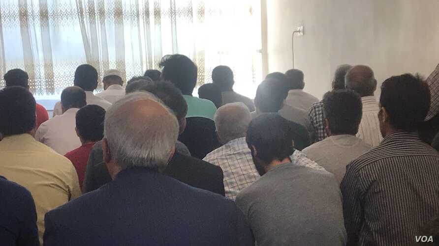 Minority Iranian Sunni Muslims gather at a prayer center in this photo published by state-affiliated news site Shafaqna as part of an Aug. 23, 2018, report about police blocking Sunni prayer centers in the capital, Tehran, on the festival of Eid al-A
