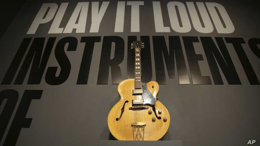 "A guitar played by Chuck Berry is displayed at the entrance to the exhibit ""Play It Loud: Instruments of Rock & Roll"" at the Metropolitan Museum of Art in New York, April 1, 2019."