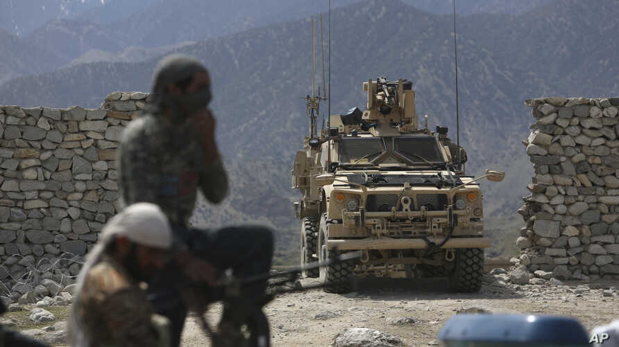 U.S. forces and Afghan security police are seen in Asad Khil near the site of a U.S. bombing in the Achin district of Jalalabad, east of Kabul, Afghanistan, April 17, 2017.