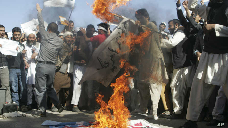 Afghans burn the U.S. flag in Herat, west of Kabul, Afghanistan, Sept. 16, 2012, during a protest against an Internet video mocking the Prophet Muhammad.