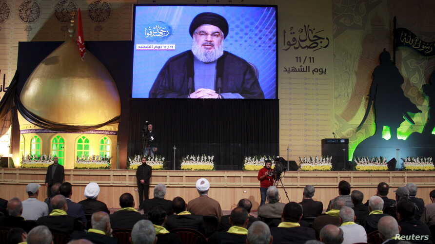FILE - Lebanon's Hezbollah leader Sayyed Hassan Nasrallah addresses his supporters via a giant screen during a rally marking Hezbollah's Martyrs' Day in Beirut's suburbs, Lebanon.