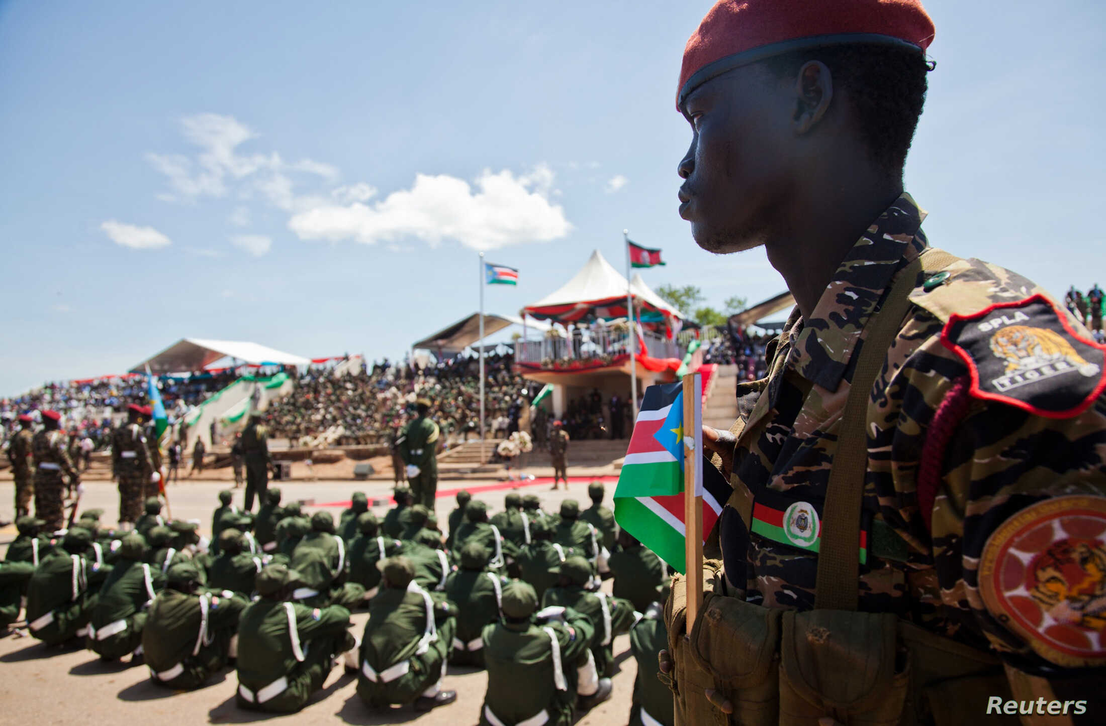 A Sudan People's Liberation Army (SPLA) soldier watches on during a parade celebrating their 29th anniversary in South Sudan's capital Juba, FILE May 16, 2012.
